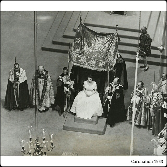 Photograph showing HM Queen Elizabeth seated in the Coronation chair, under a canopy which was placed over her and held by the four Knights of the Garter, for the Anointing by the Archbishops.