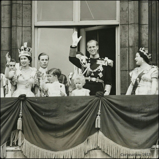 hotograph showing HM Queen Elizabeth II and members of the royal family standing on the balcony of Buckingham Palace, after the coronation. The Queen wears the Imperial State Crown, cuffs and chain of the Order of the Garter. Included in the group are HRH Prince Philip, Duke of Edinburgh, Queen Elizabeth The Queen Mother, Princess Margaret, Prince Charles and Princess Anne, two of the Queen's Maids-of-Honour.