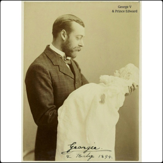 Photograph of King George V, when George Duke of York, standing in left side profile as he holds his infant son, Prince Edward of York, who later became King Edward VIII then the Duke of Windsor.  The portrait was probably taken when Prince Edward was Christened at White Lodge, Richmond, on the 16th July 1894 by the Richmond firm of photographers, Gunn and Stuart.