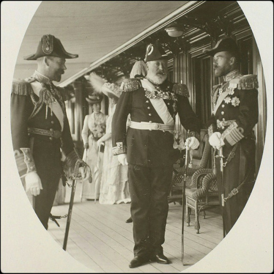 Photograph of King Edward VII (b.1841-d.1910), the Prince of Wales (b.1865-d.1936), later King George V, & Nicholas II, Emperor of Russia (b.1868-d.1918) on the deck of the Russian Imperial Yacht Standart during the Cowes Regatta, Isle of White 1909