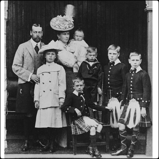 Photograph of King George V & Queen Mary with their six children (from left to right): Princess Mary (later Princess Royal) (b.1897-d.1965), Prince John (b.1905-d.19), in his mother's arms, Prince Henry, later Duke of Gloucester (b.1900-d.74) (seated), Prince George, later Duke of Kent (b.1902- d.42). Prince Edward (later King Edward VIII, then Duke of Windsor) (b.1894-d.1972), Prince Albert (later King George VI) (b.1895-d.1952). .