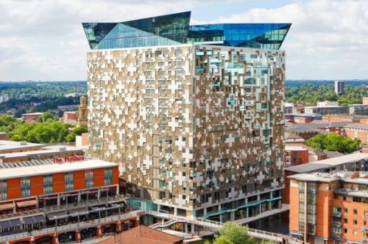 The Cube is a 25 storey mixed-use development in the centre of Birmingham, England. Designed by Ken Shuttleworth of MAKE Architects, it contains 135 flats, 111,500 square feet of offices, shops, a hotel and a 'skyline' restaurant